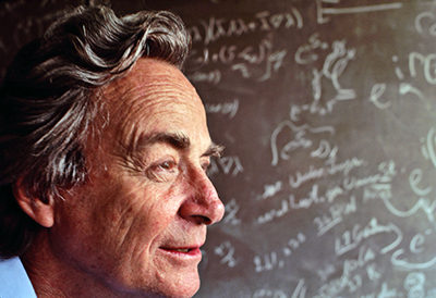 March 1983, Los Angeles, California, USA --- Nobel Prize winning physicist Richard Feynman stands in front of a blackboard strewn with notation in his lab in Los Angeles, Californina. --- Image by © Kevin Fleming/CORBIS